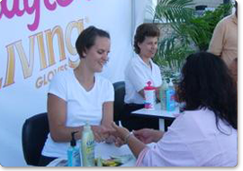 Chair massage therapists giving a hand massage during a marketing tour